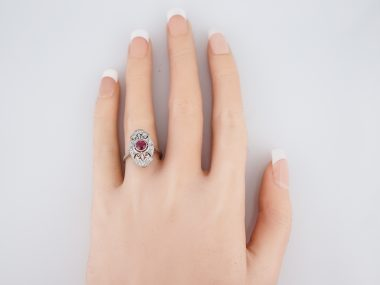 Modern Right Hand Ring .63 Round Cut Ruby in 18k White Gold