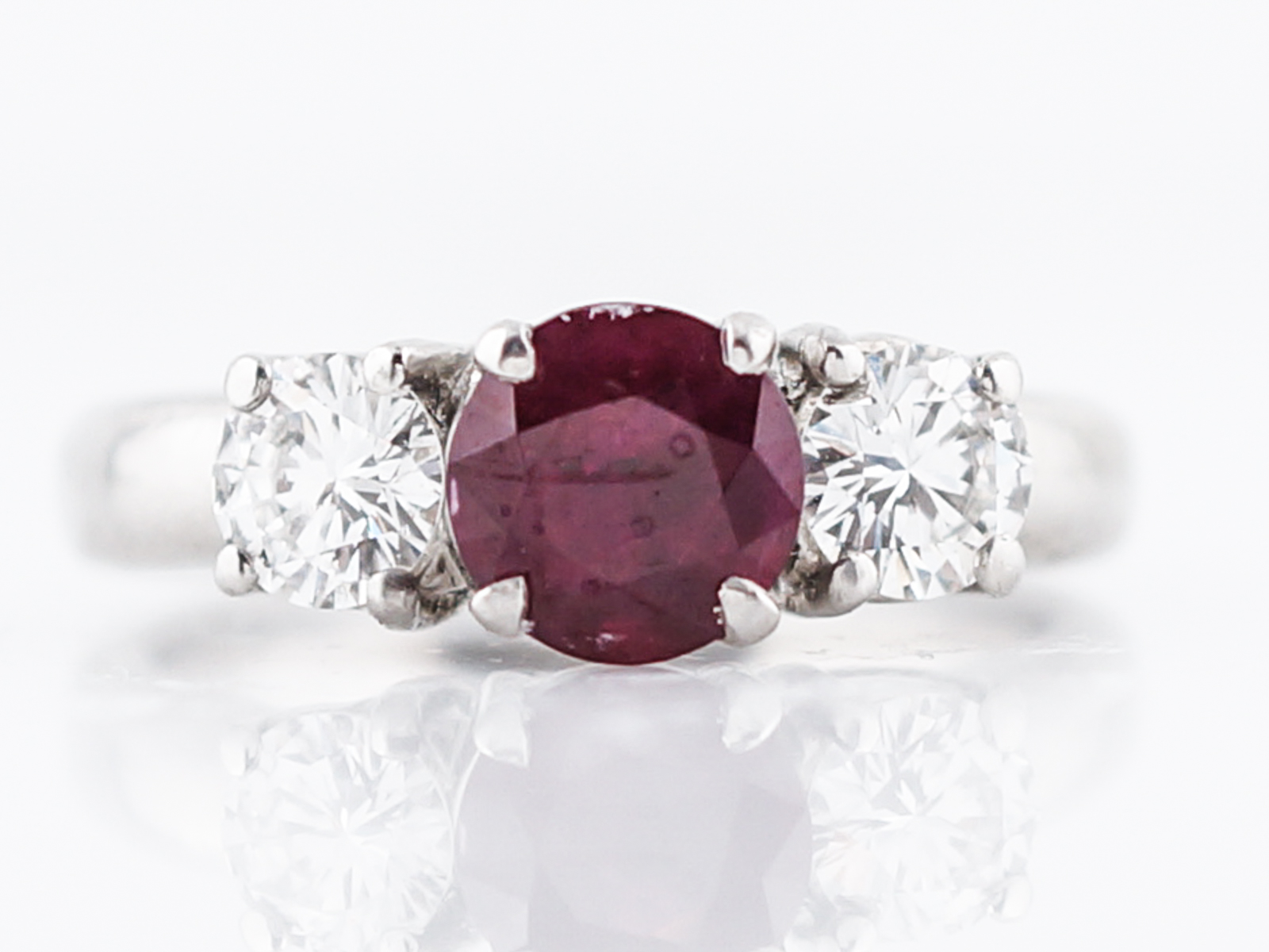 Ruby & Diamond Three Stone Engagement Ring in Platinum