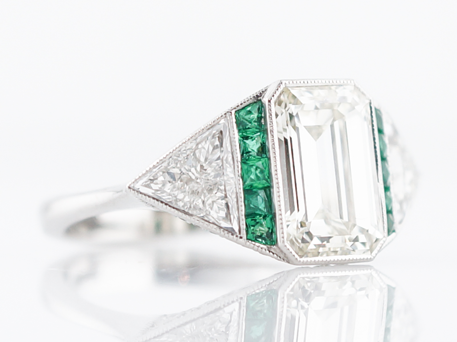 engagement ring modern 2 51 emerald cut diamond 15 emeralds in