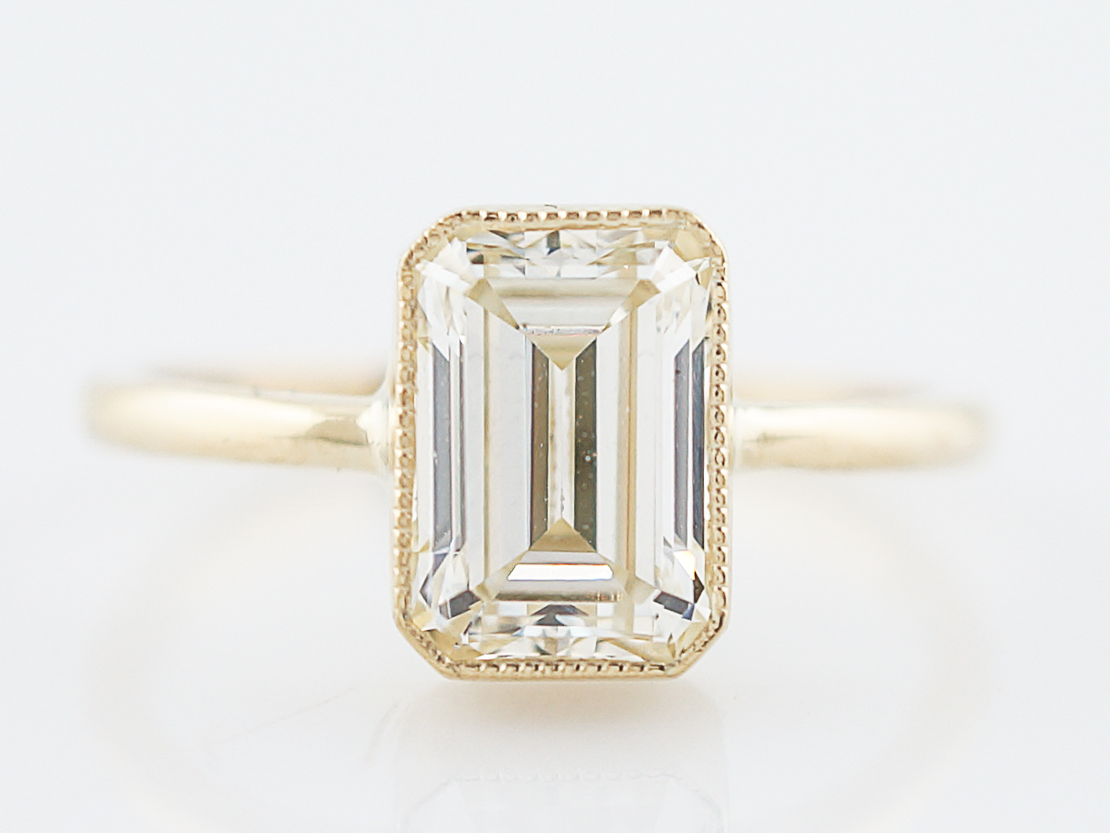 rectangular ring diamond emerald halo deco