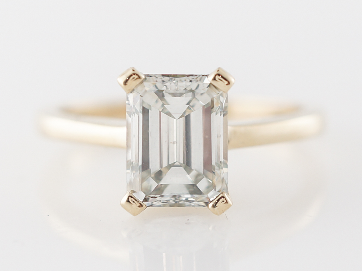 Emerald Cut Diamond Engagement Ring in Yellow Gold
