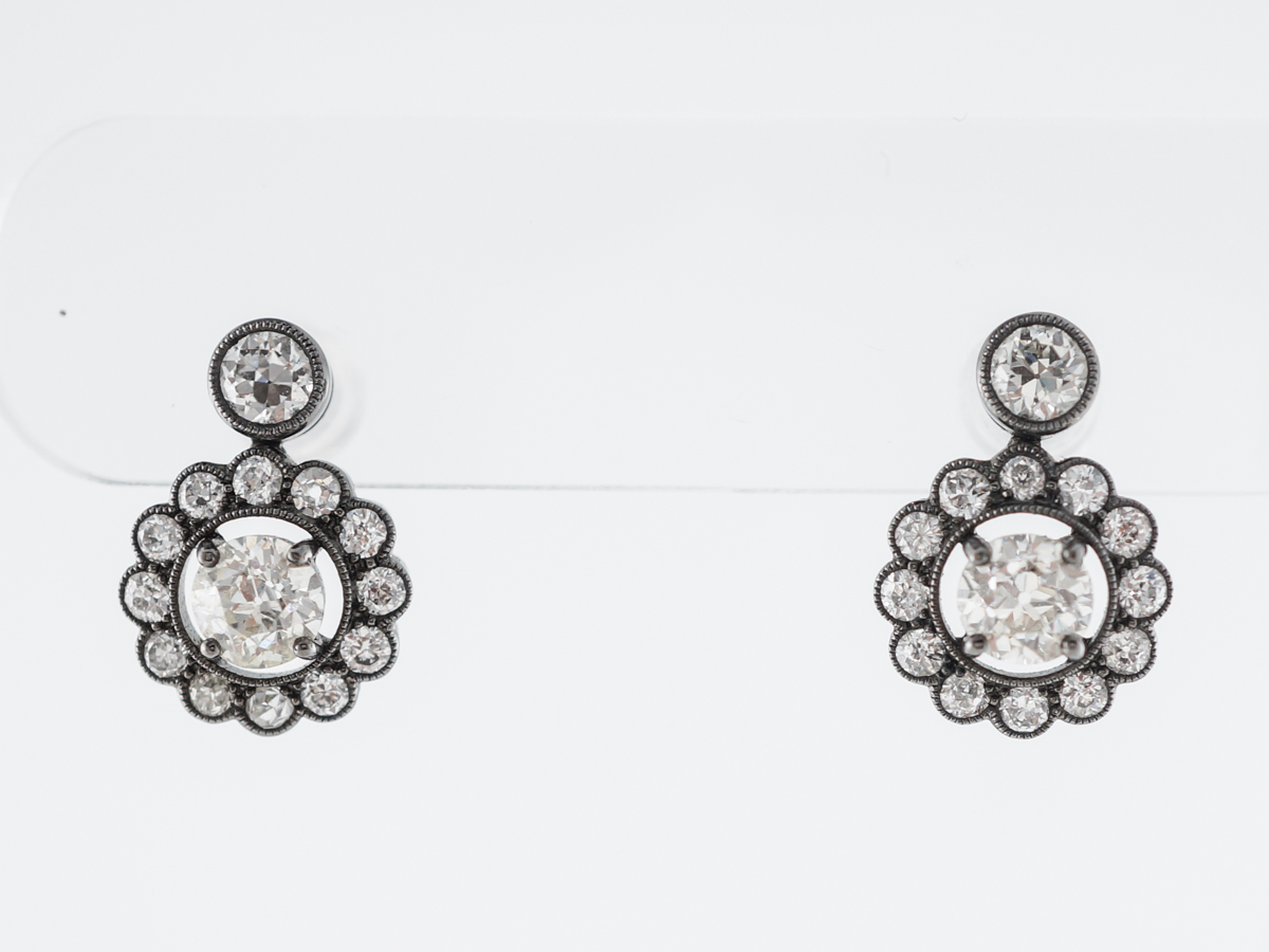Vintage Style Diamond Halo Earrings in Platinum