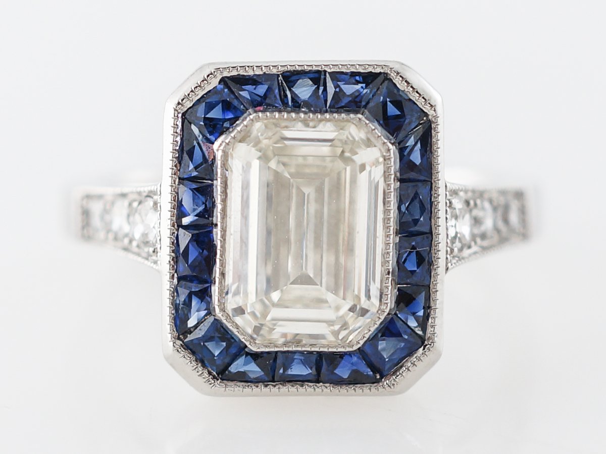 Halo Engagement Ring w/ Emerald Cut Diamond