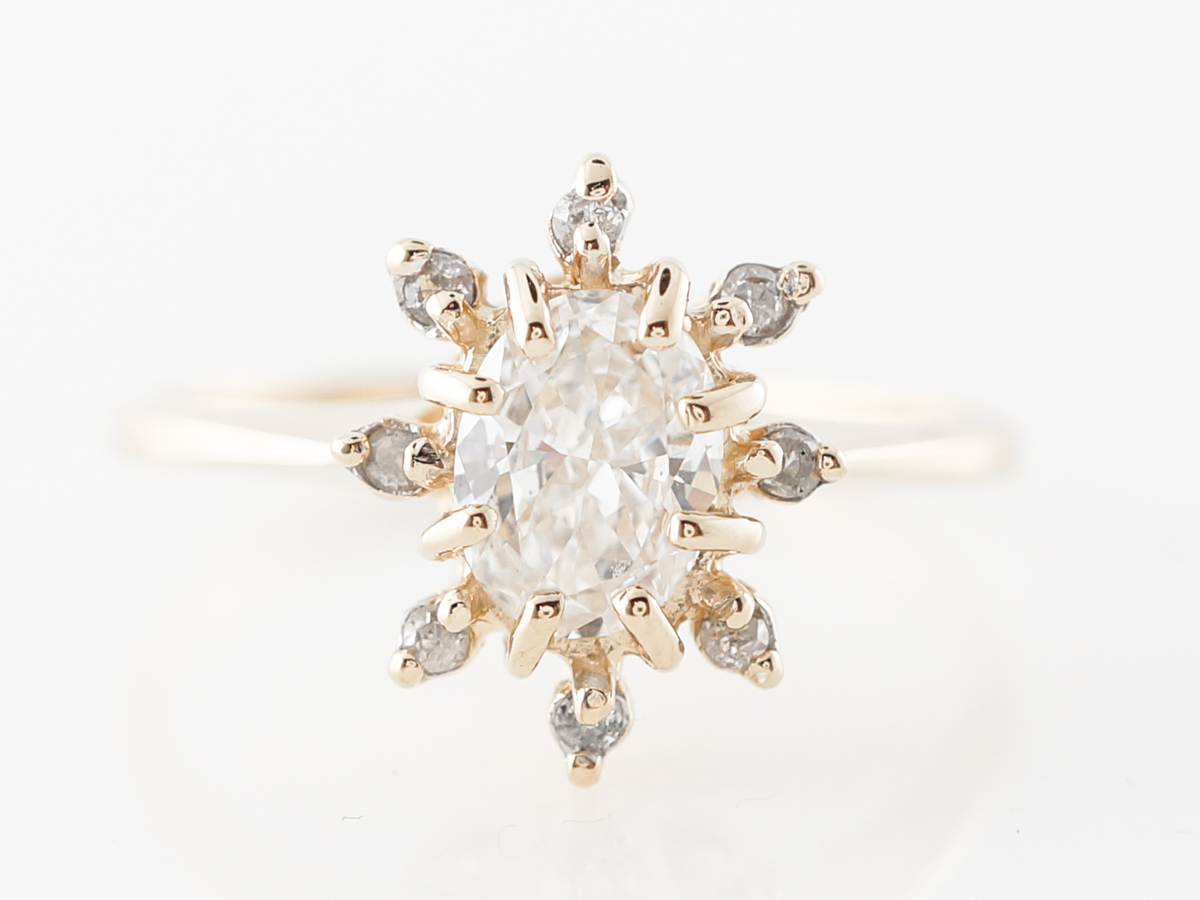 Oval Diamond Halo Engagement Ring in Yellow Gold
